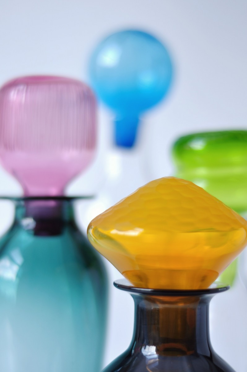 Close up of multi coloured glass bottle stoppers