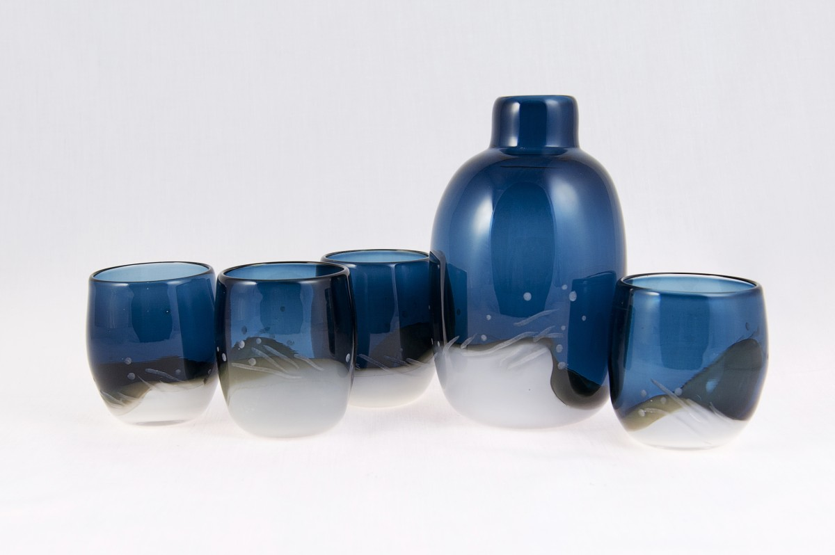 Blue and white blown glass flask with four glasses