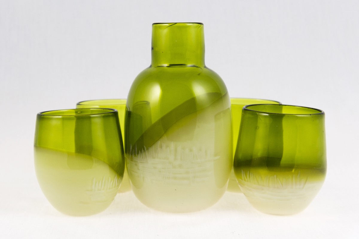 Green and cream coloured blown glass flask and four glasses