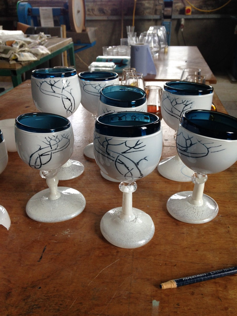 Blue and white stemmed glasses with whiplash design