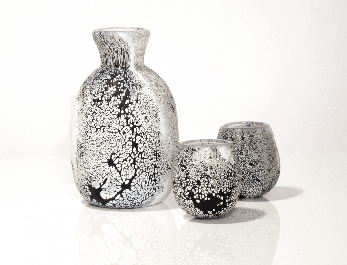 Glass flask and two small cups with black and white pattern