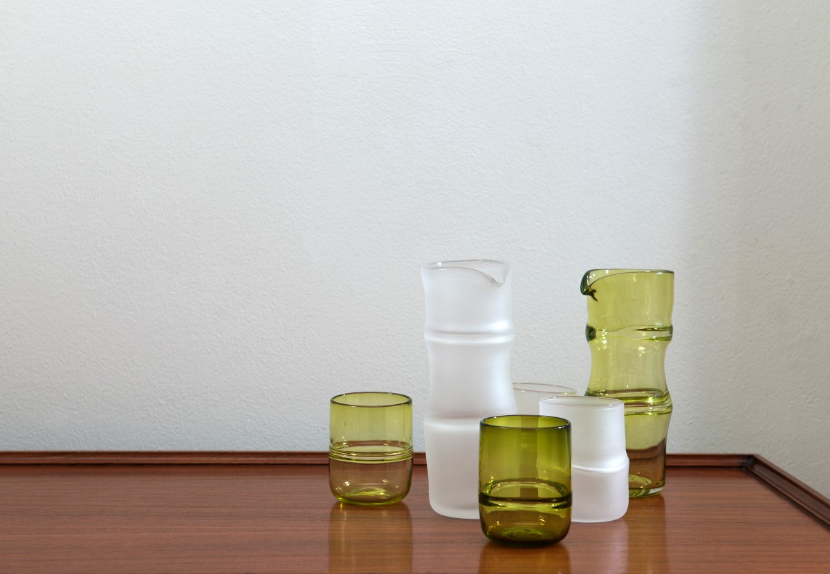 Green and clear glass flasks and glasses with bamboo forms