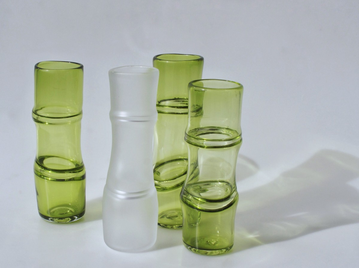 Four vases in green and clear glass with bamboo form