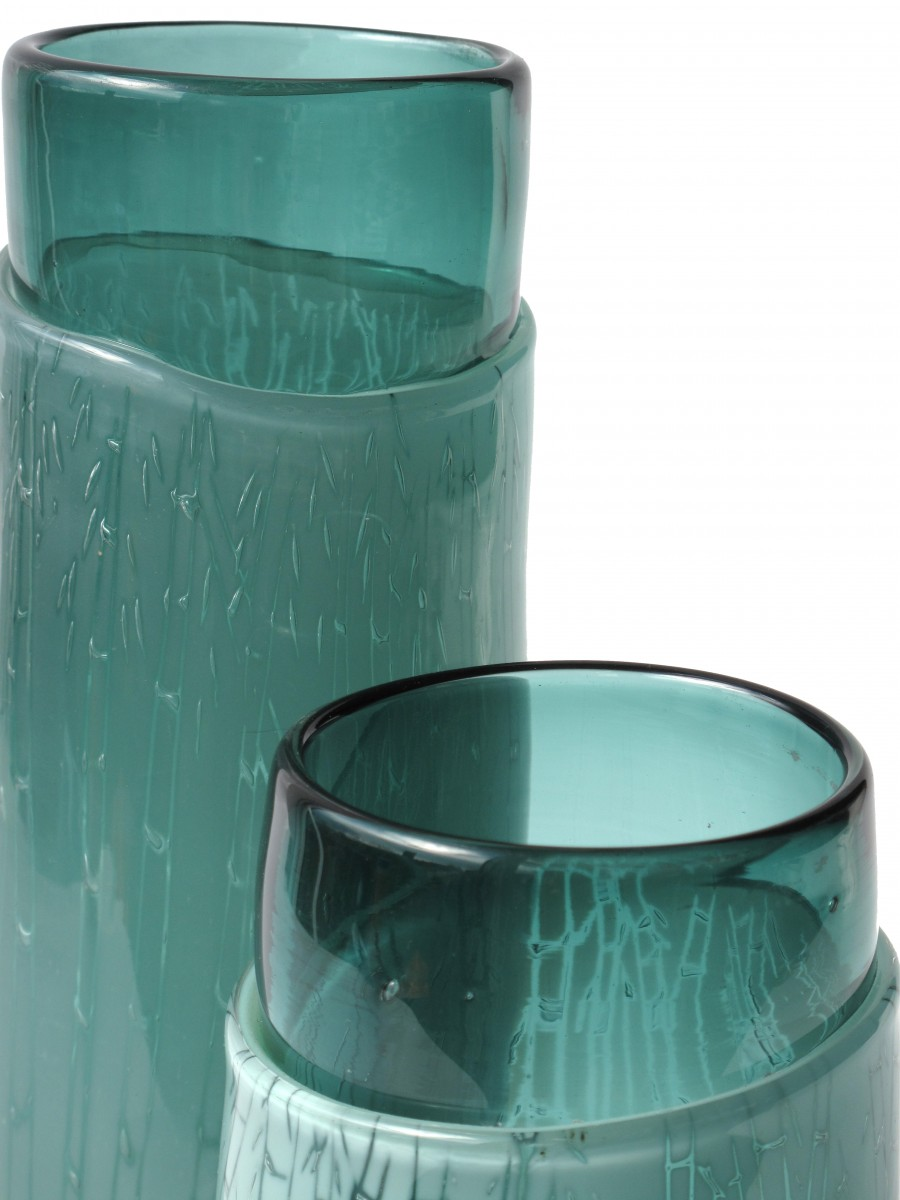Detail of two green glass vases with engraved bamboo pattern