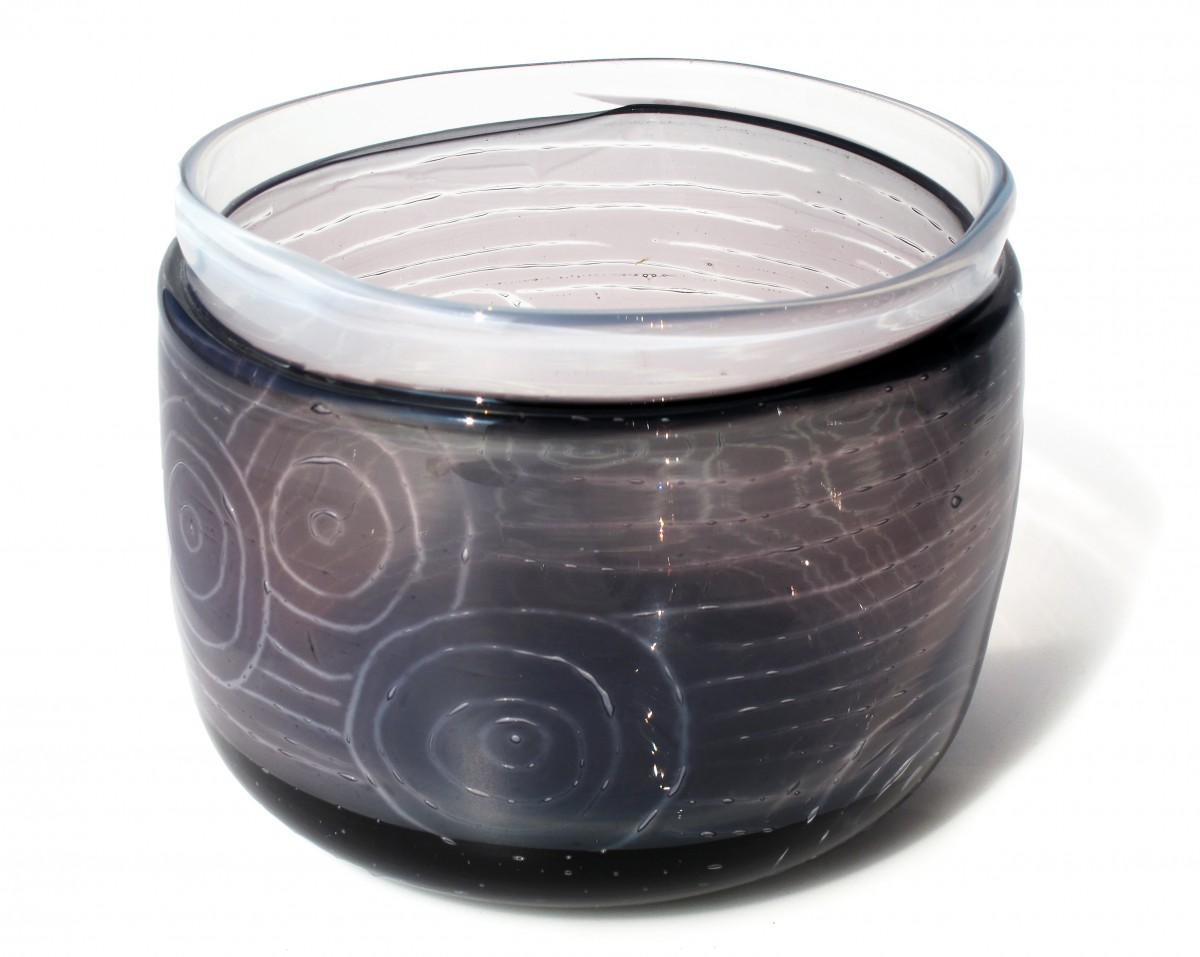 Grey and white straight sided glass bowl with engraved patterns