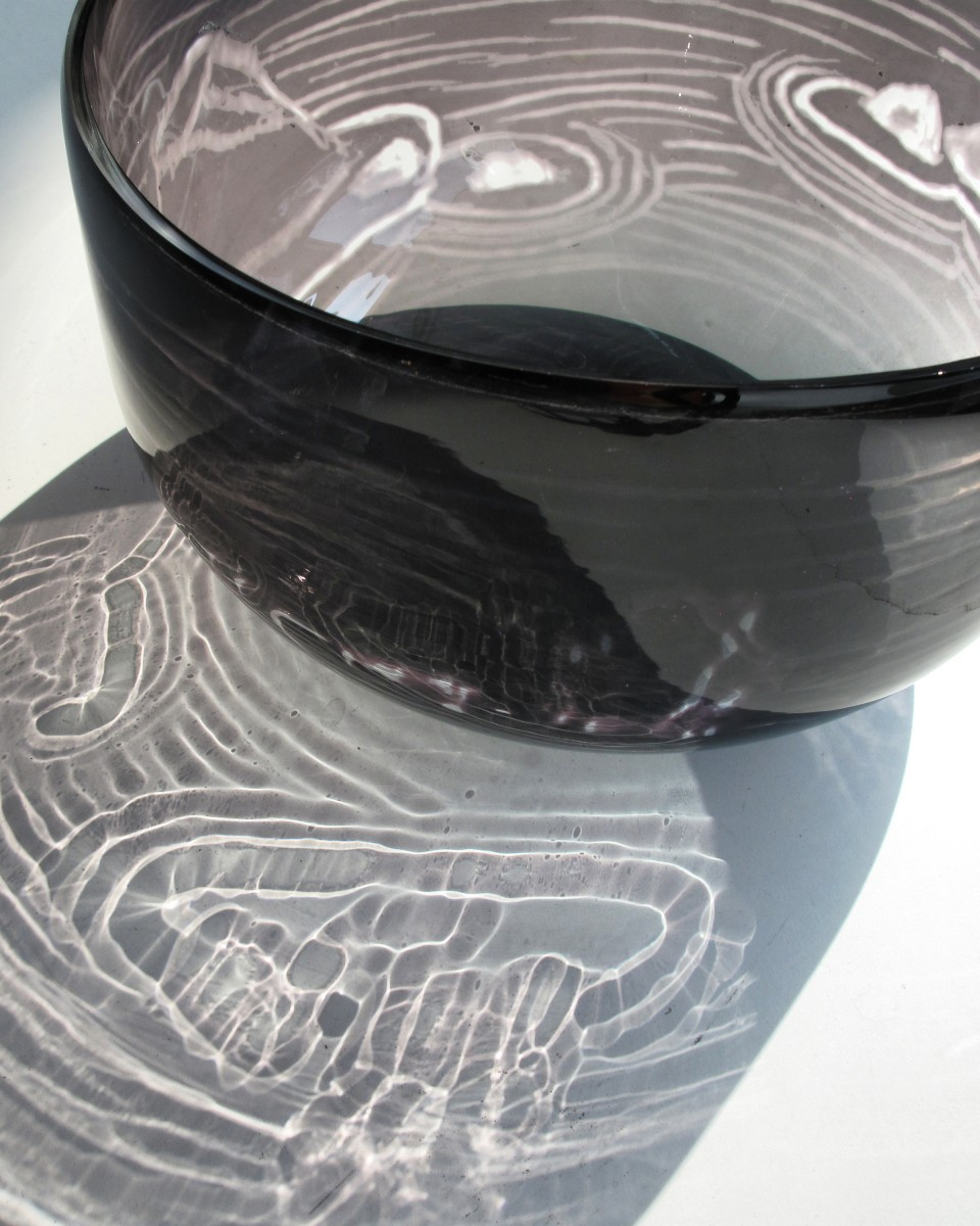 Grey transparent glass bowl with engraving