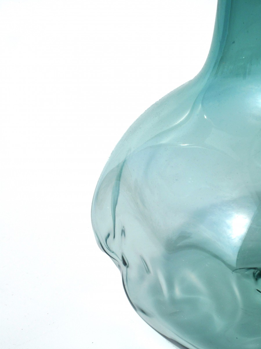 Detail of steel green glass decanter