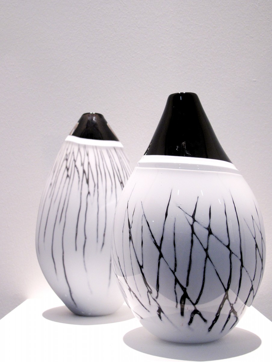 Two black and white glass vases with vertical black line patterns