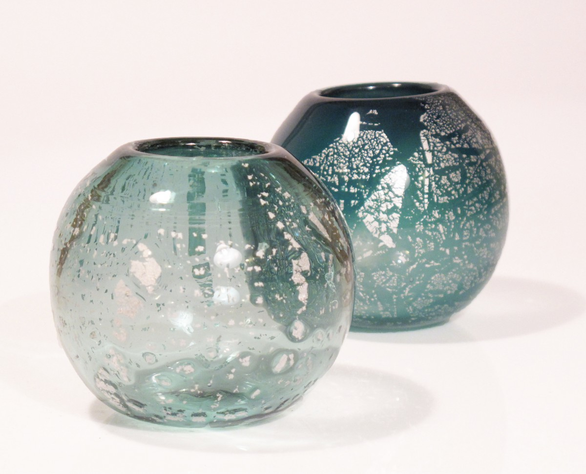 Two round glass candle holders in green with silver leaf
