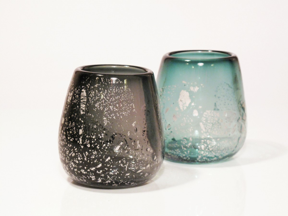 Two glass candle holders in grey and steel with silver leaf