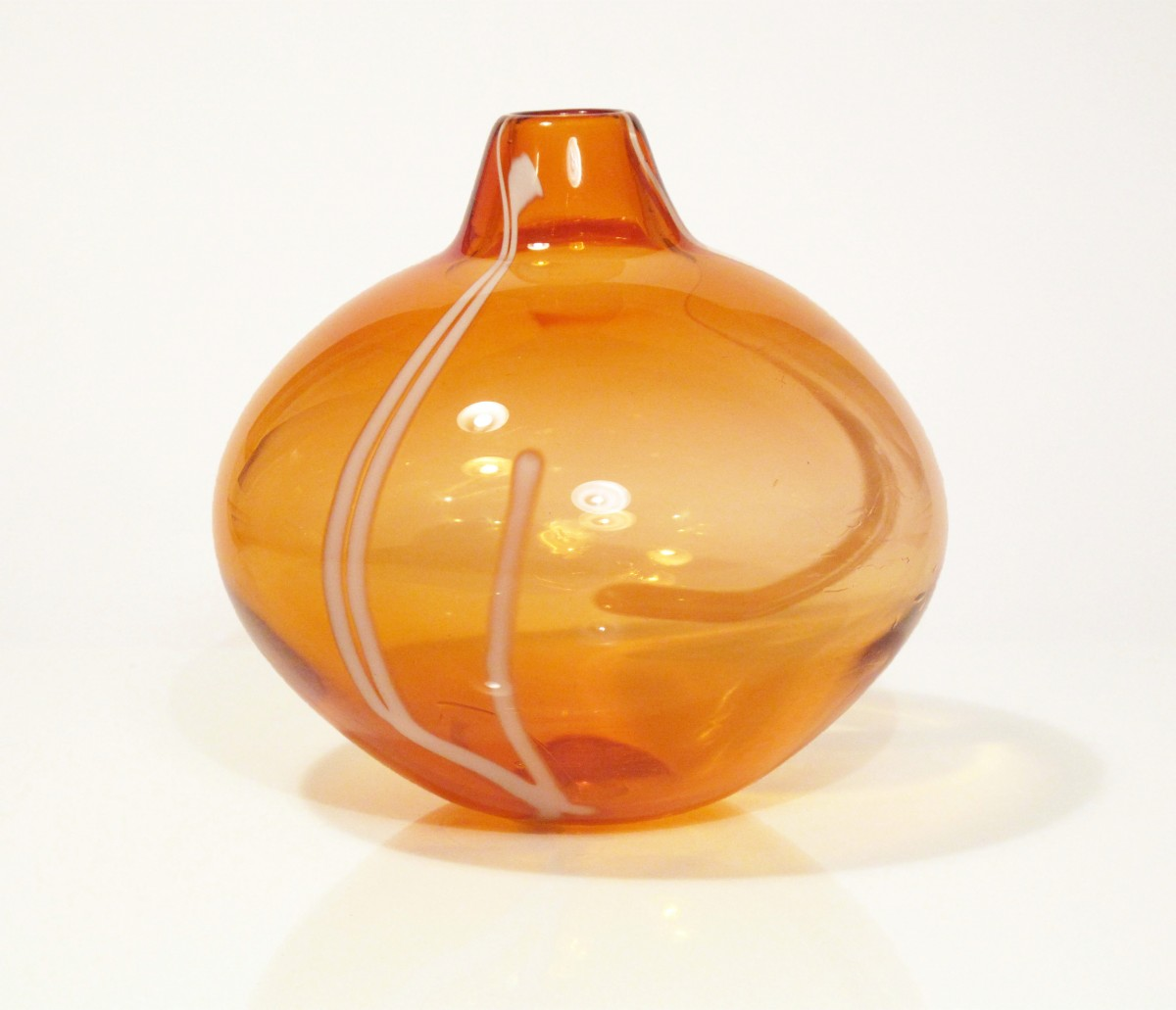 Apricot coloured blown glass vase with white stripes