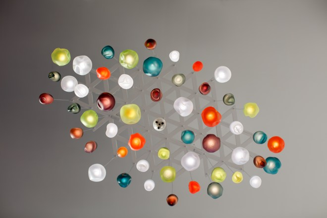 View from below of multi-coloured glass chandelier