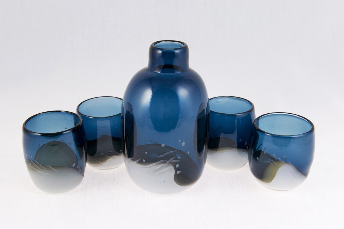 Blue and white glass flask with four tumblers.